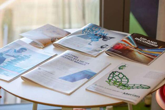 financial print ads examples on table